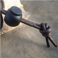 Adjustable button on hat lanyard